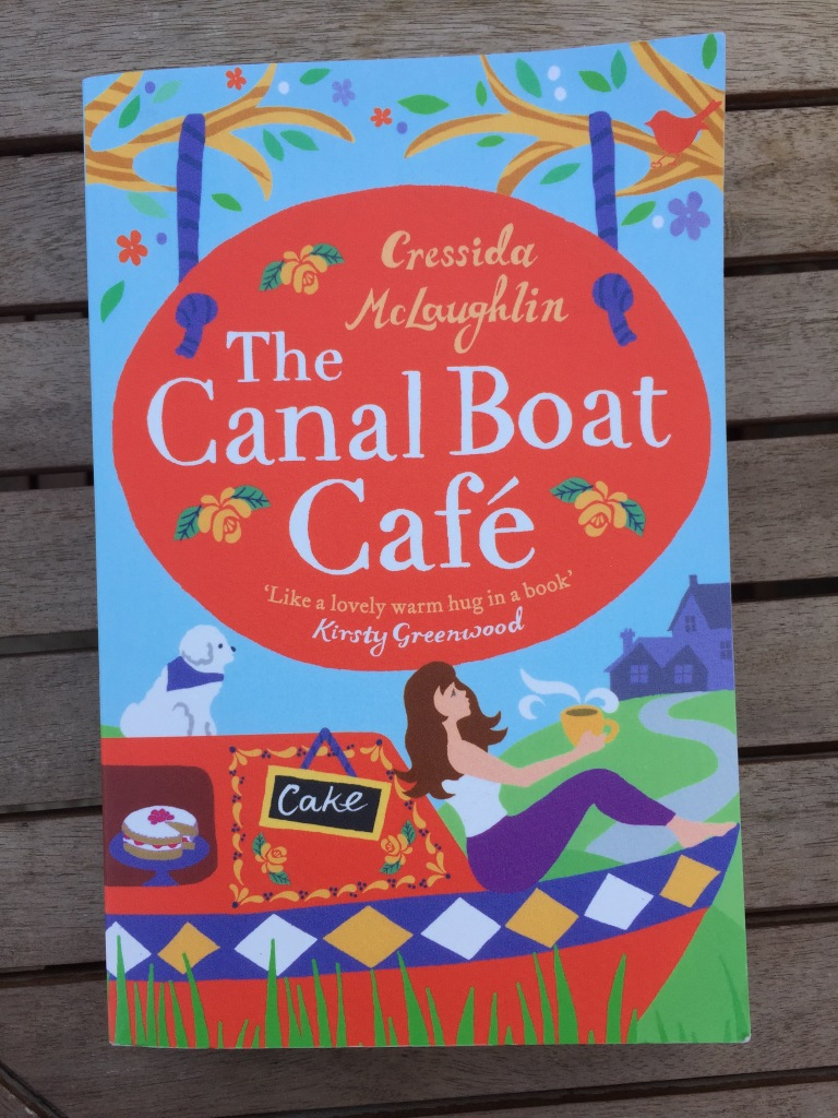 Paperback copy of The Canal Boat Café