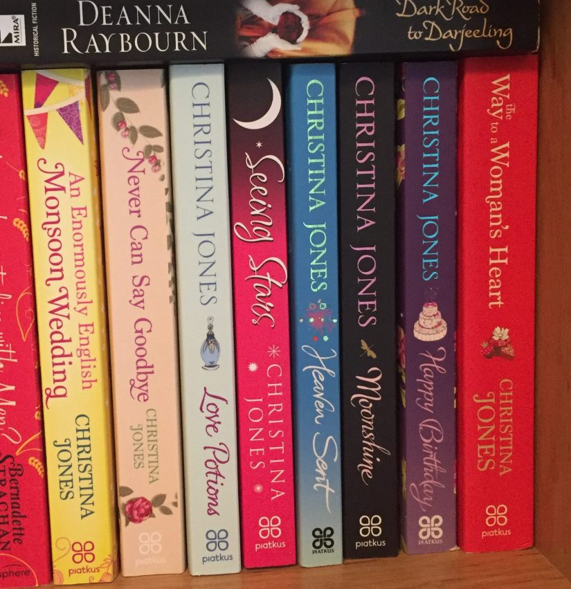 A selection of books by Christina Jones on a bookshelf.