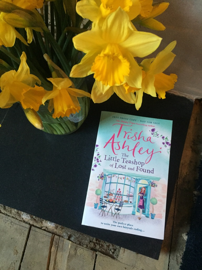Trisha Ashley's Little Teashop of Lost and Found and some daffodils.