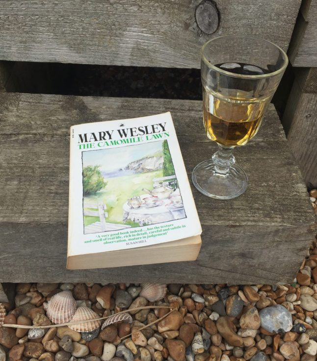 A copy of The Camomile Lawn and a glass of Pimms