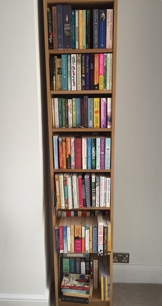 A very full bookshelf