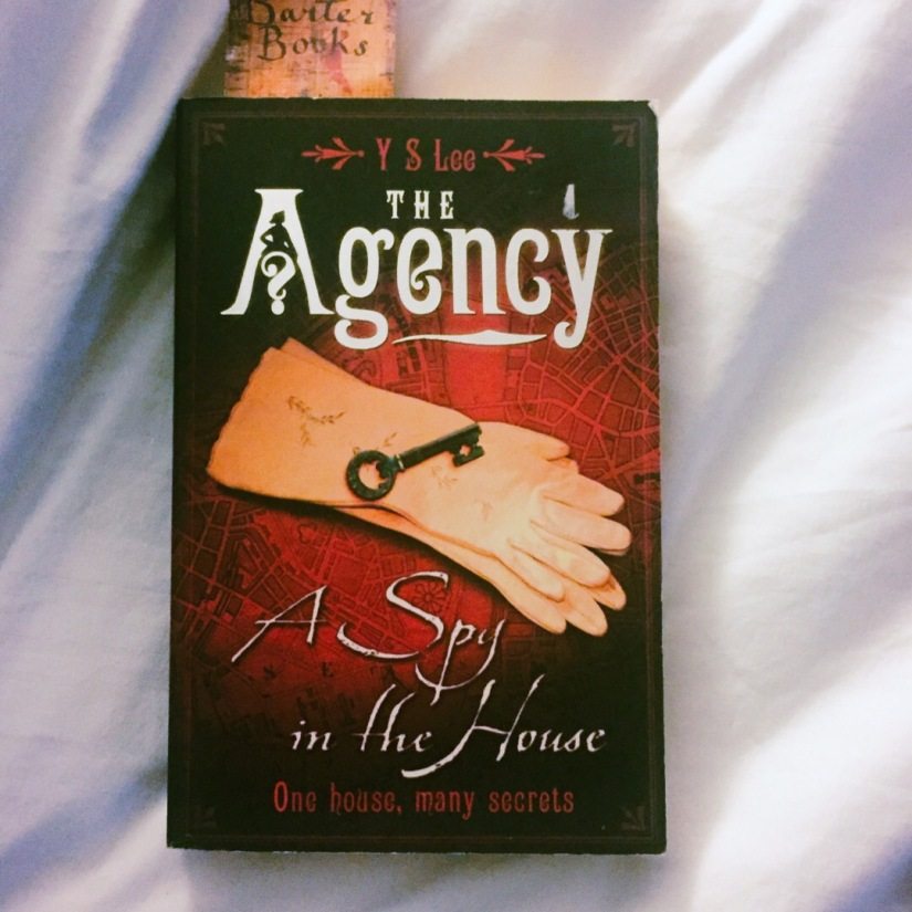 Paperback copy of the Agency