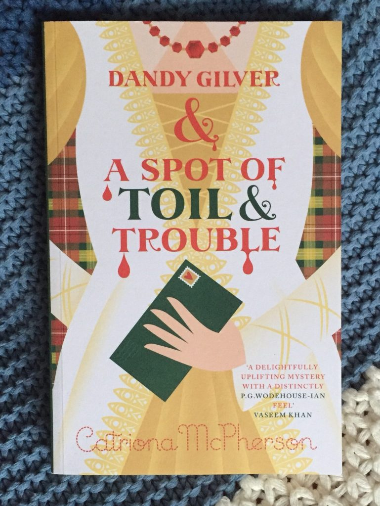 paperback copy of Dandy Gilver and a Spot of Toil and Trouble
