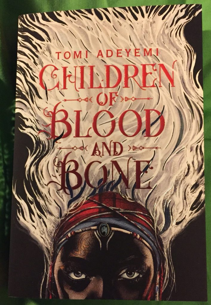 Paperback copy of Children of Blood and Bone