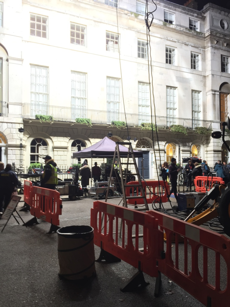 Film crew with powerful lights outside a Georgian town house in Bloomsbury