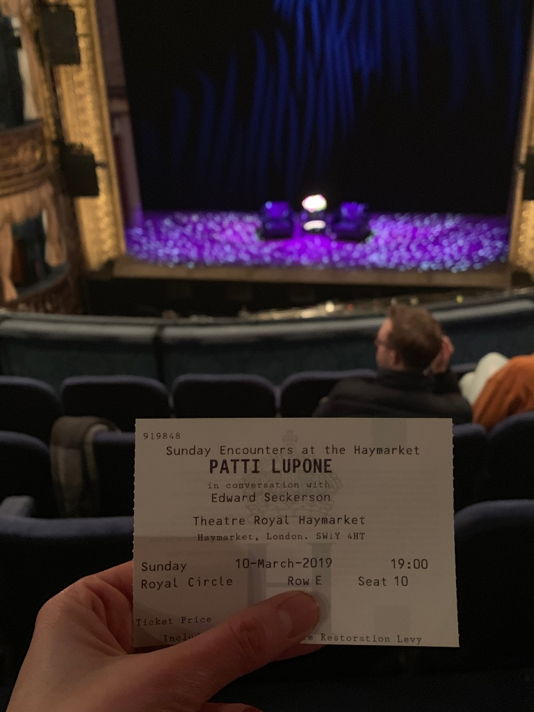 theatre ticket and stage in the background