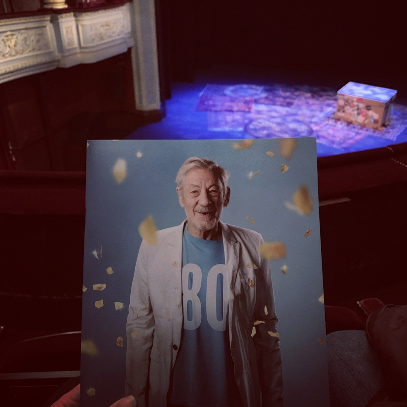 Theatre programme with picture of Sir Ian McKellen with a stage in the background