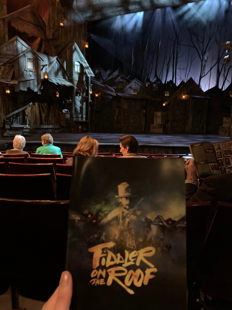 Programme and stage set up of Fiddler on the Roof