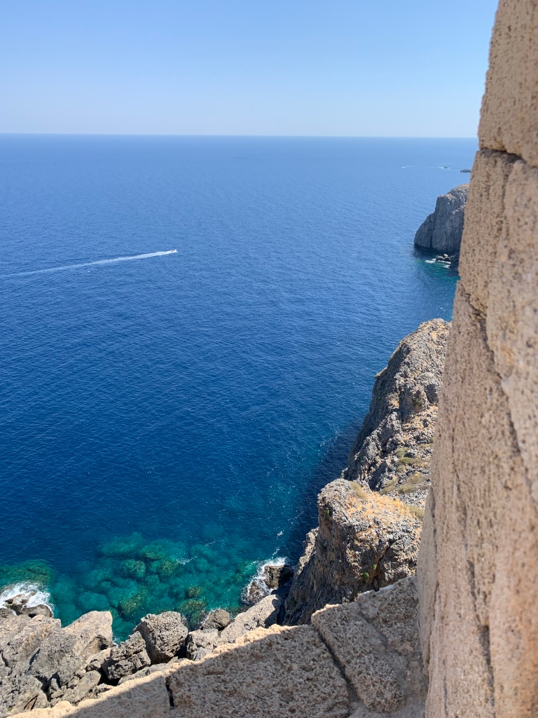 Sea, rocks, blue sky - the Greek coast at Lindos