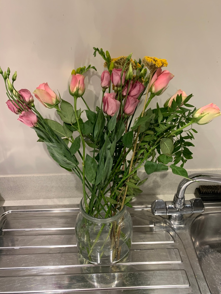 badly arranged flowers in a vase...