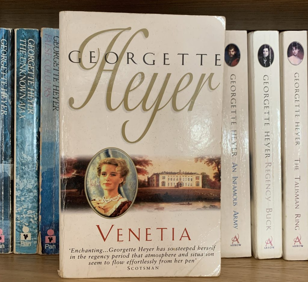 Well-loved copy of Venetia with other Heyer books behind it