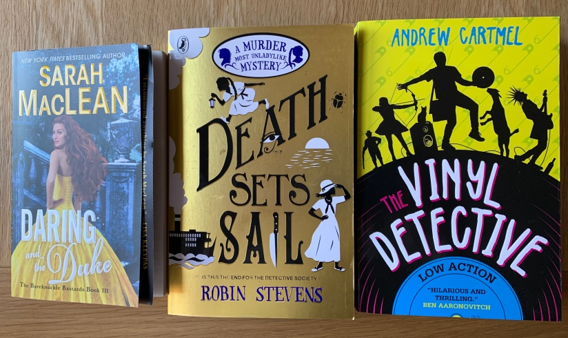 Copies of Daring and the Duke, Death Sets Sail and The Vinyl Detective
