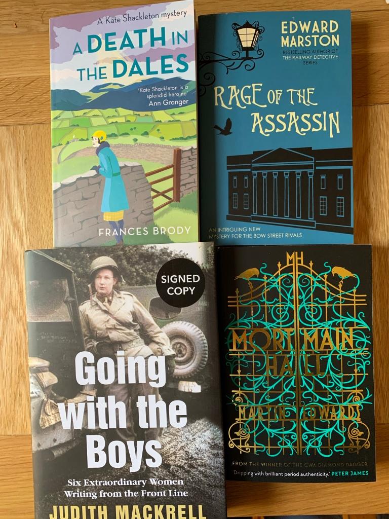 Four books on a desk