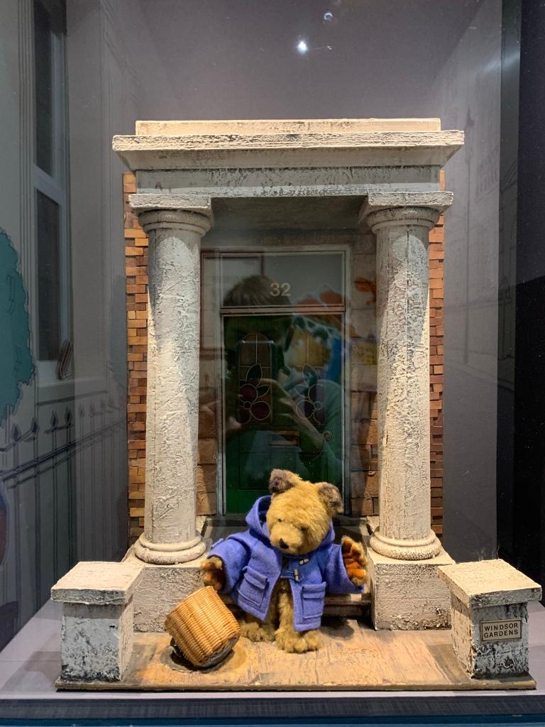 A model Paddington sitting outside the door to Windsor gardens